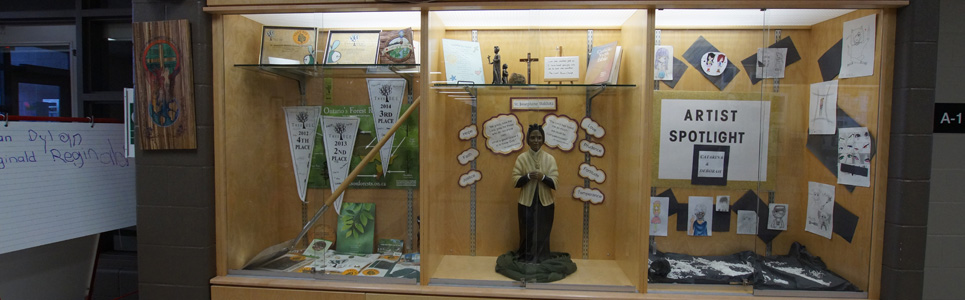 Display board with awards and statue of St. Josephine Bakhita